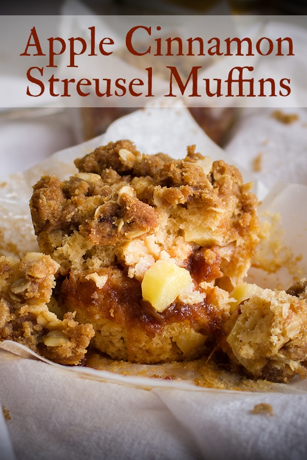 An apple cinnamon muffin with apple butter and streusel broken apart so you can see the inside.