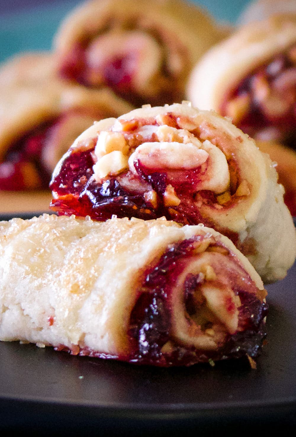 A plate of two cherry almond rugelach cookies.