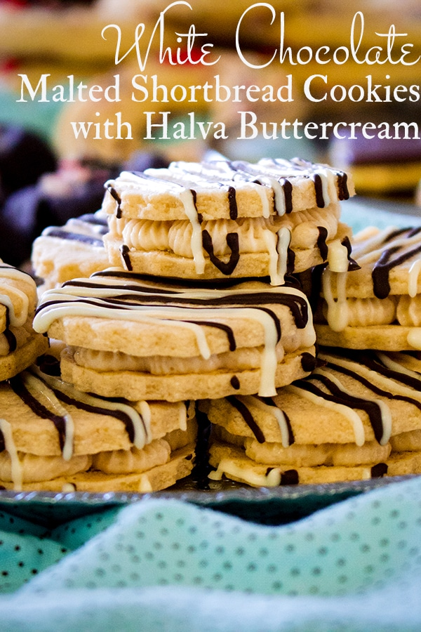 A tray of white chocolate malted shortbread sandwich cookies filled with halva buttercream.