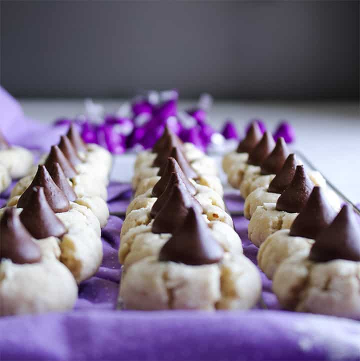 Rows of Pecan Sand Tarts with chocolate kisses.