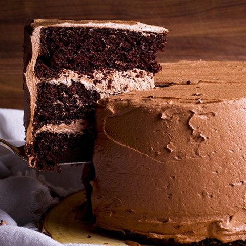 Serving a slice of three layer Chocolate Devil's Food Cake frosted with Chocolate Buttercream.