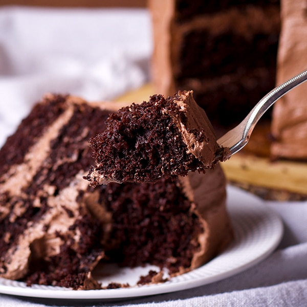 Taking a bite of Devil's Food cake frosted with Chocolate Buttercream.