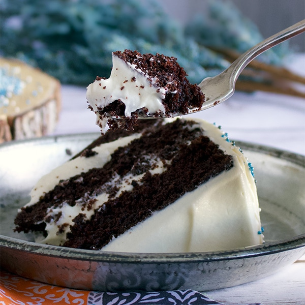 Taking a bite of Devil's Food Cake frosted with Cream Cheese Buttercream.