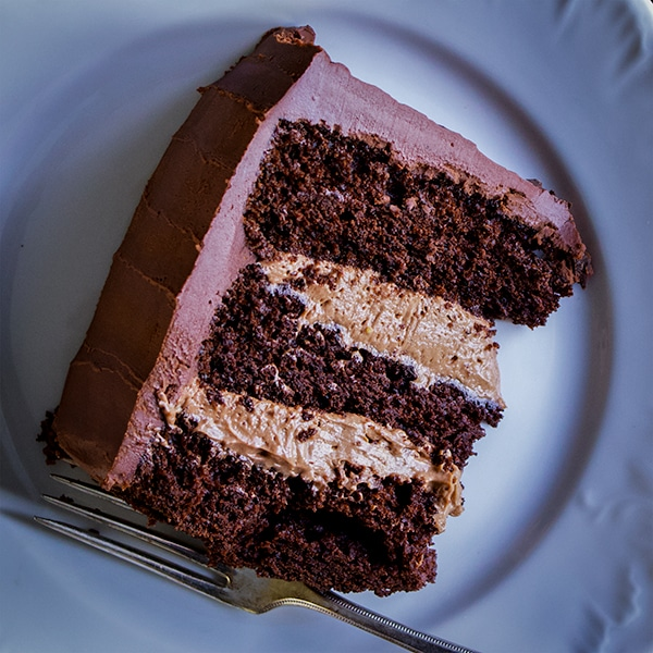 A slice of three-layer chocolate blackout cake.