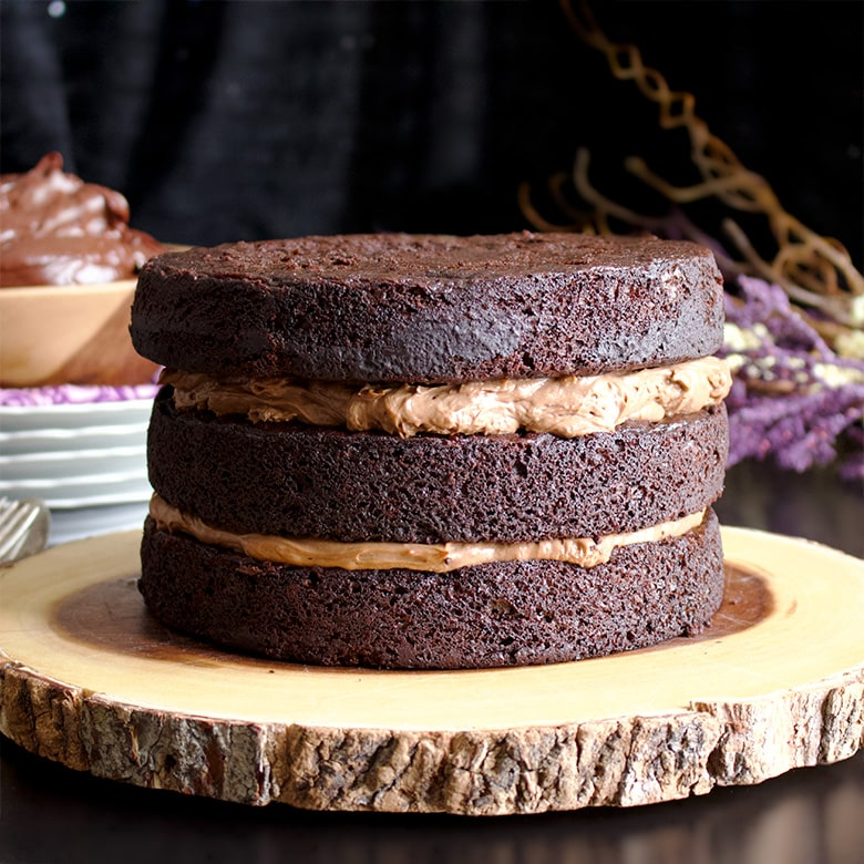 Layering three Devil's Food Cakes with chocolate pastry cream to make Chocolate Blackout Cake.