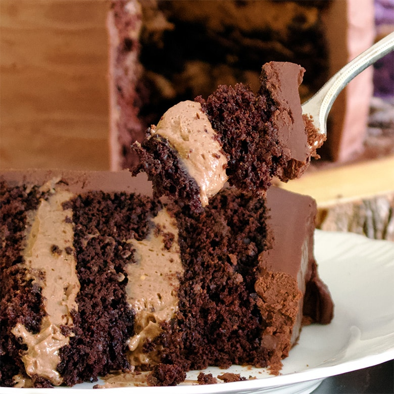 Taking a bite of chocolate blackout cake.
