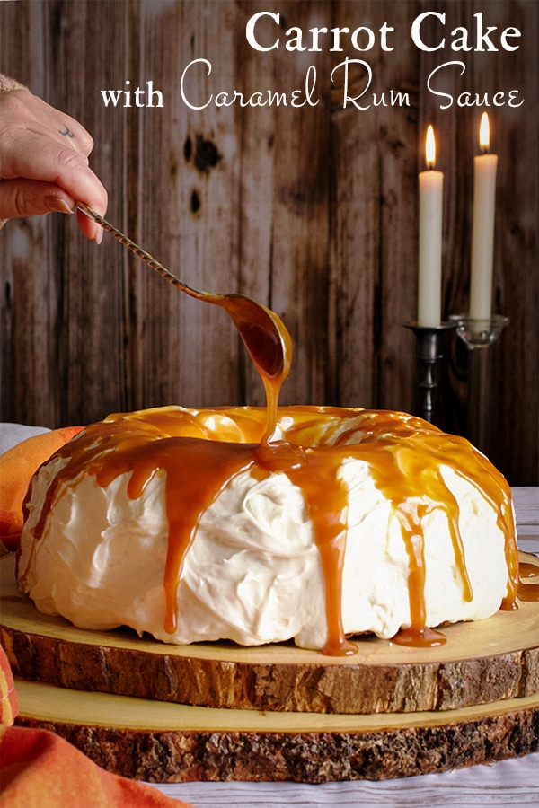 Drizzling caramel rum sauce over a carrot cake frosted with cream cheese buttercream.