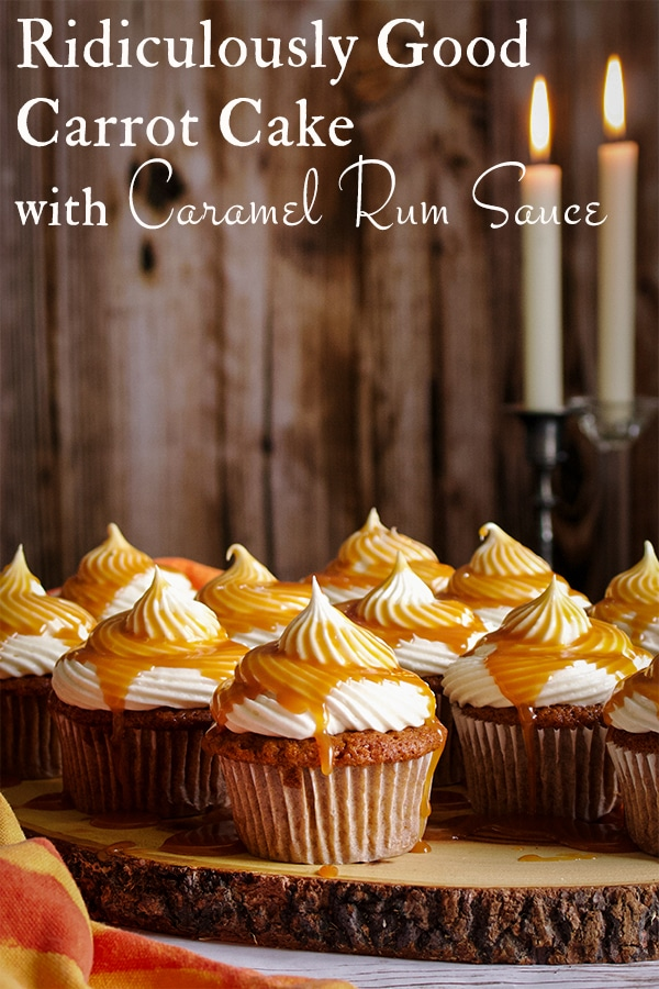 Carrot cake cupcakes frosted with cream cheese buttercream and covered with caramel rum sauce.