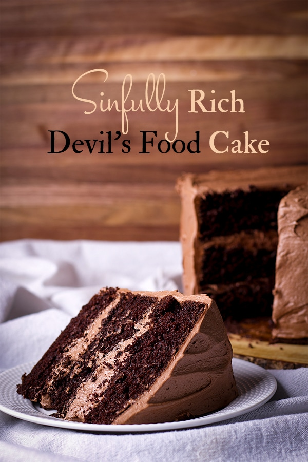 A slice of Devil's Food Cake frosted with Chocolate Buttercream.