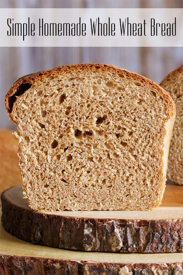 A loaf of Simple Homemade Whole Wheat Bread, cut open so you can see the inside.