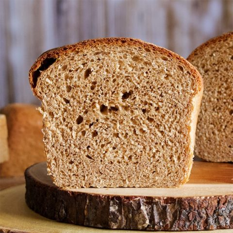 The inside of a loaf of a loaf of homemade whole wheat bread.