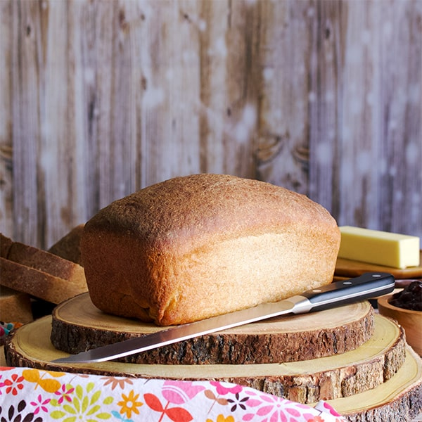 A loaf of homemade whole wheat bread.