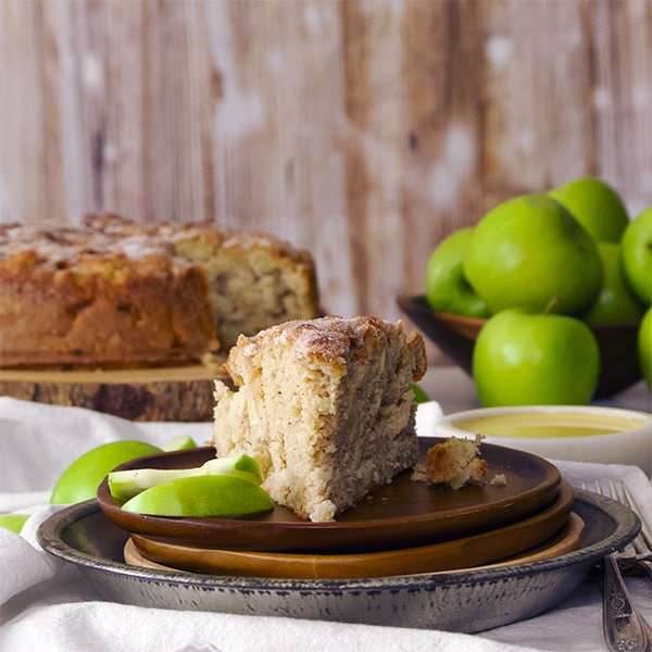 A slice of Irish Apple Cake with Custard Sauce