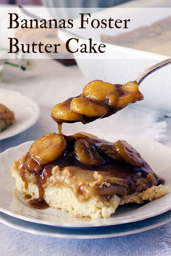 Spooning bananas foster sauce over a piece of gooey butter cake.