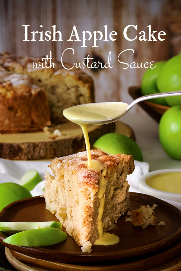 Irish Apple Cake. Tart, crisp apples suspended in tender vanilla spice cake with a crunchy sugar topping and creamy vanilla custard sauce. #irishapplecake #applecake #irish #recipe #cake #custard | ofbatteranddough.com