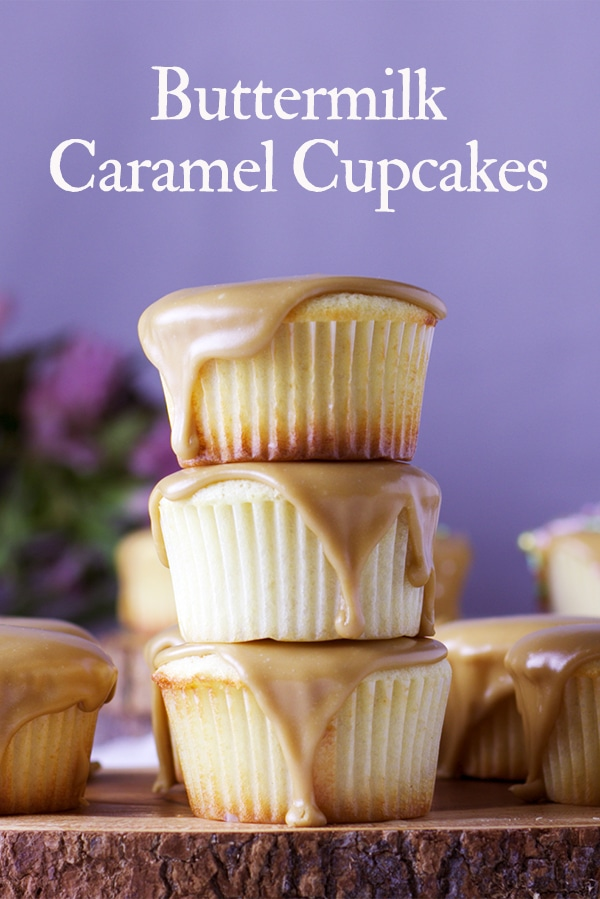Three Buttermilk Caramel Cupcakes stacked on top of each other.