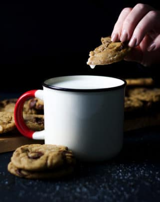 Dipping a soft chocolate chip cookie in milk.