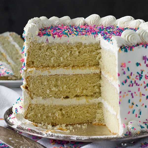 The inside of a three layer gluten free vanilla cake with Italian Meringue Buttercream