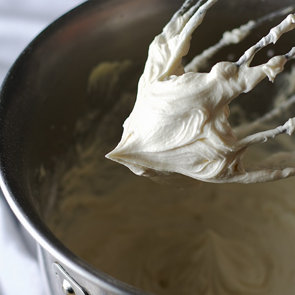 Lifting a beater from a bowl of American Buttercream.