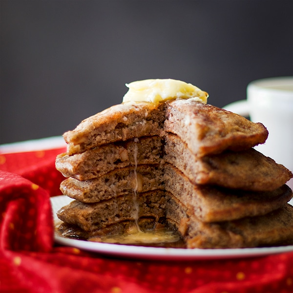 A stack of Apple Cinnamon Pancakes with butter.