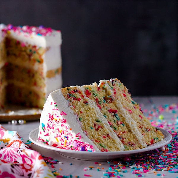 A slice of Funfetti Cake with Classic American Buttercream.