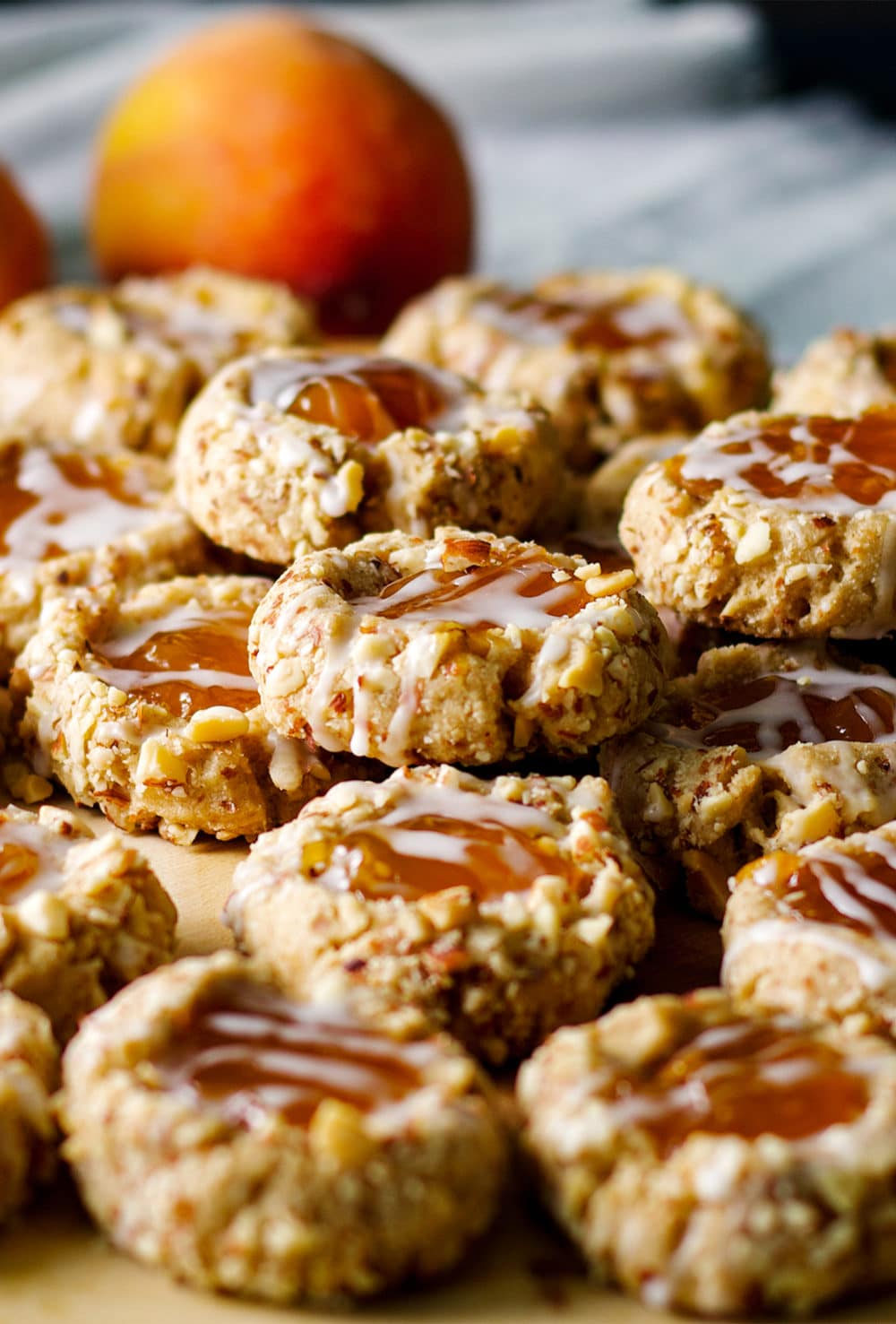 A tray of peach almond thumbprint cookies.