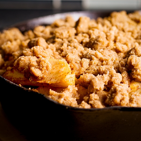Apple Cobbler baked in a cast iron skillet with brown sugar cookie topping.