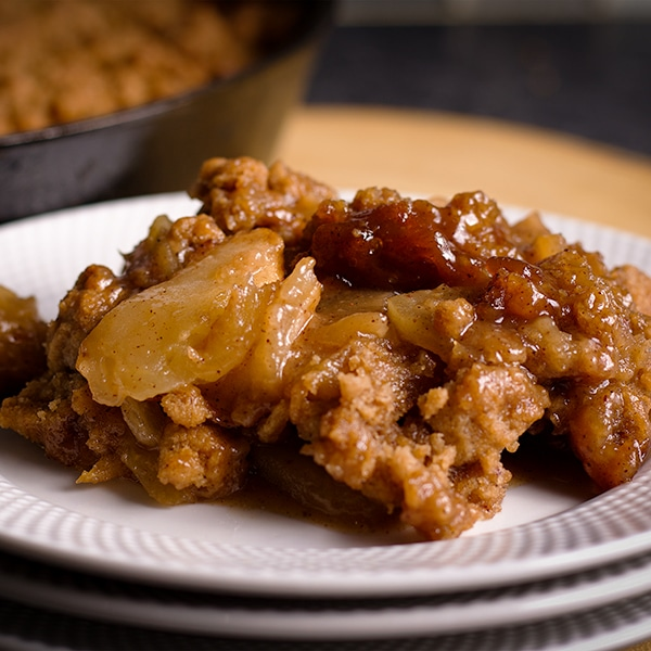 A serving of warm Apple Cobbler with Brown Sugar Cookie topping.