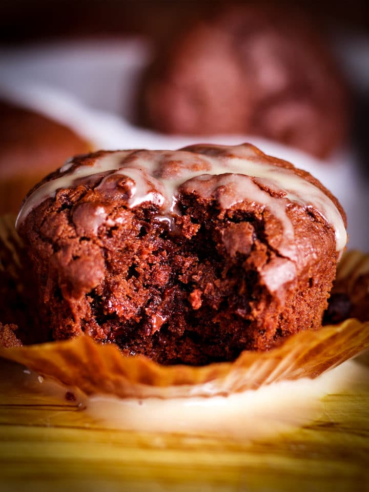 A Chocolate Muffin with a bite taken out of it.
