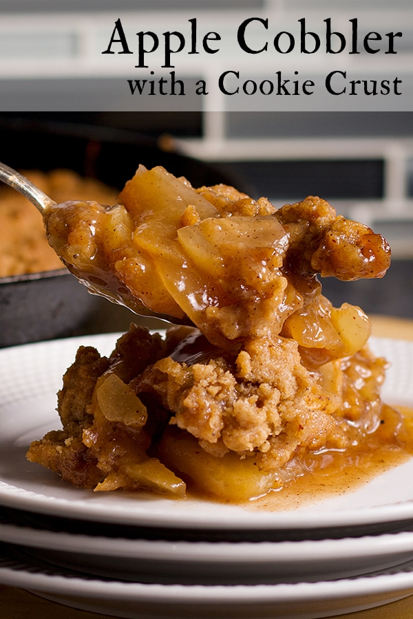 Dishing up a serving of warm Apple Cobbler.