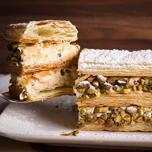 Serving a slice of Cannoli Napoleon.