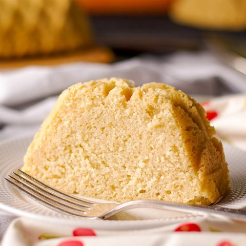 A slice of all-butter pound cake on a plate.