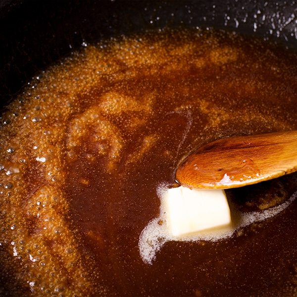 Cooking brown butter maple sauce for roasted fruit.