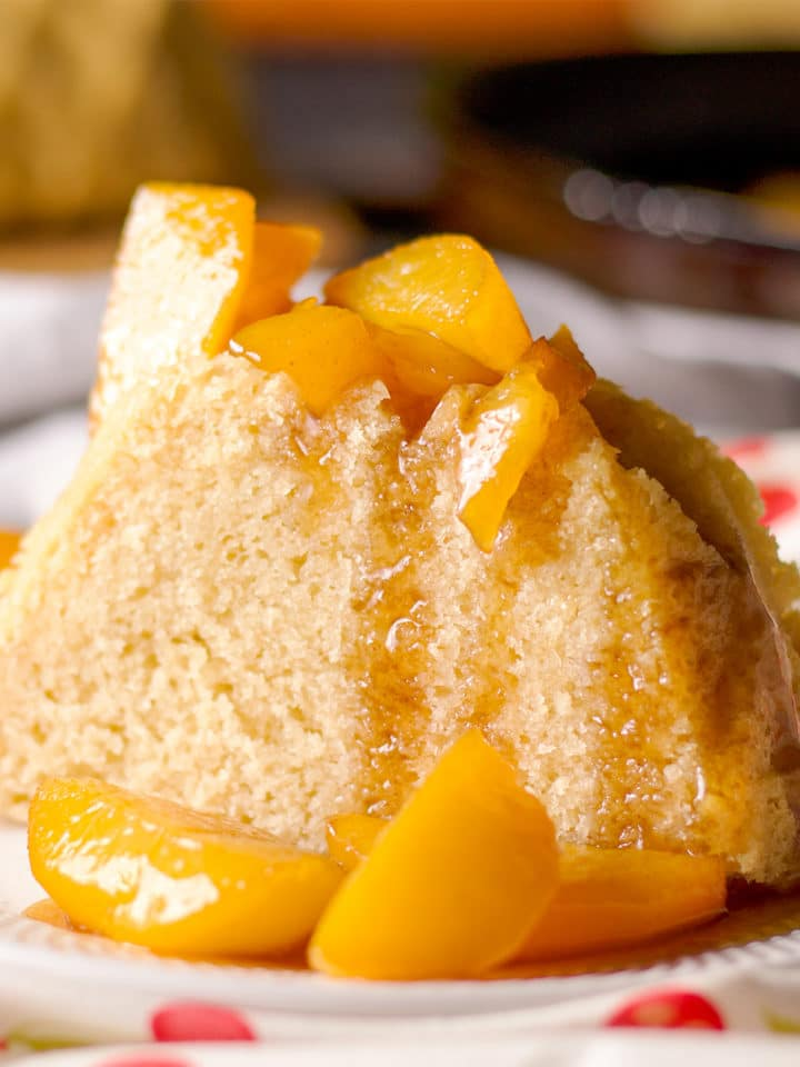 A slice of pound cake covered with maple brown butter roasted fruit.