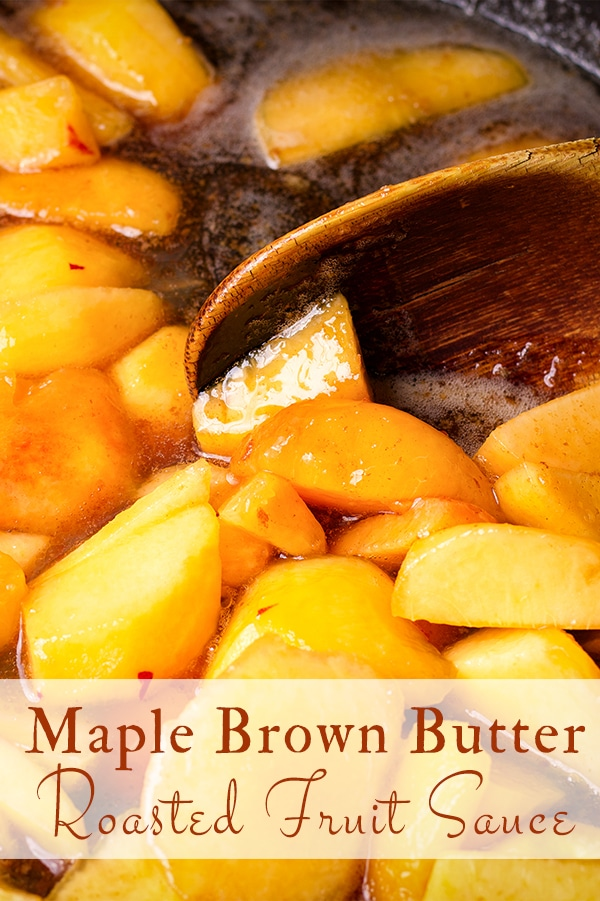 Using a wooden spoon to stir maple brown butter roasted fruit sauce as it cooks.