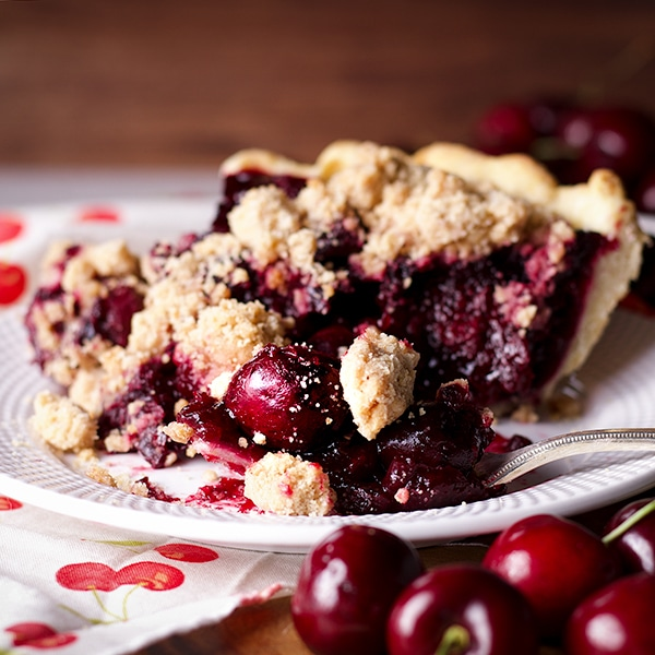 Taking a bite of a slice of Cherry Crumb Pie