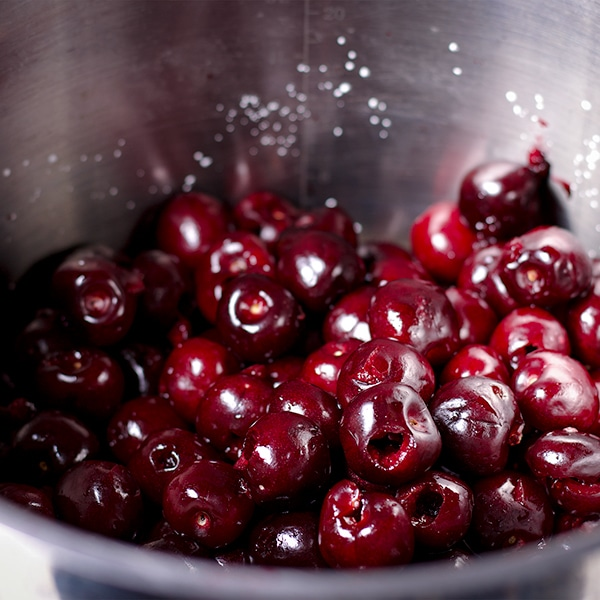 A pan of pitted sweet cherries.