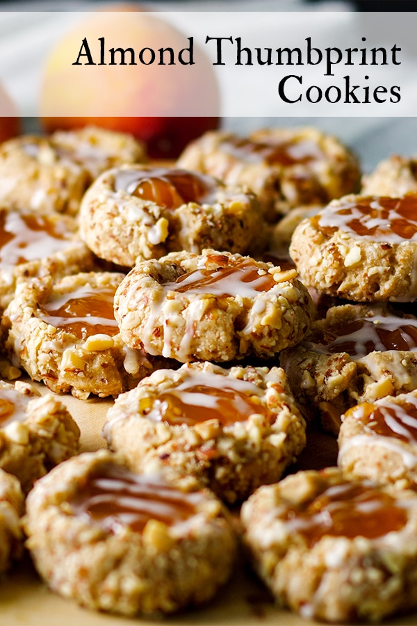 A wood tray filled with Almond Thumbprint Cookies