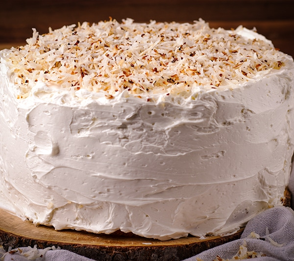 Coconut cream cake frosted with Coconut buttercream and decorated with toasted coconut.