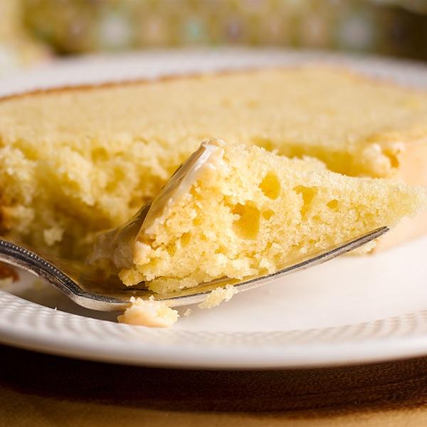 Taking a bite of lemon loaf cake.