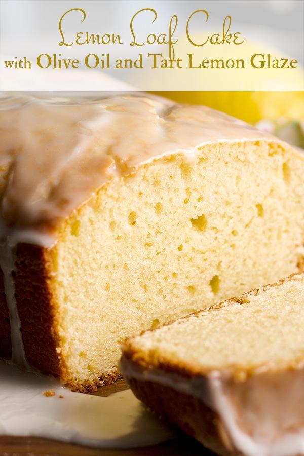 Lemon Loaf Cake on a wooden tray, sliced.