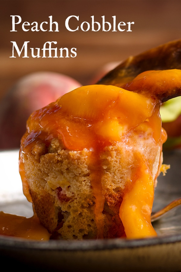 Spooning peach sauce over the top of a peach cobbler muffin.
