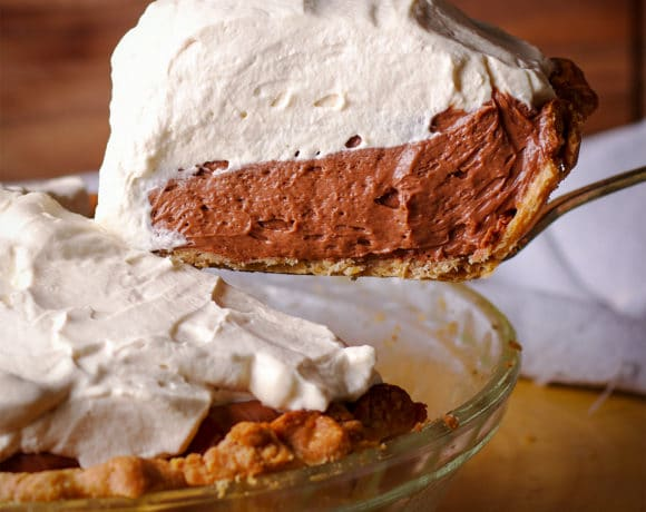 Serving a slice of extra creamy chocolate cream pie.