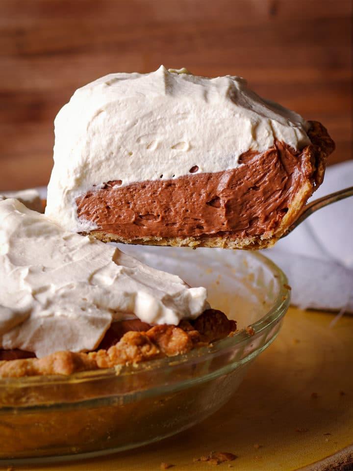 Serving a slice of extra creamy chocolate cream pie.