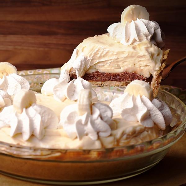 Serving a slice of Black Bottom Banana Cream Pie with Rum Custard.