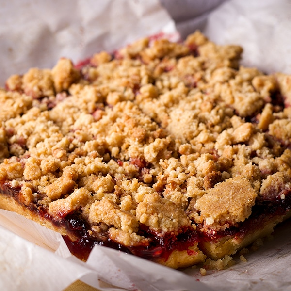 Cherry shortbread crumble bars, baked, cooled, and ready to slice into individual bars.