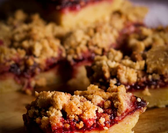 A tray of cherry shortbread crumble bars.