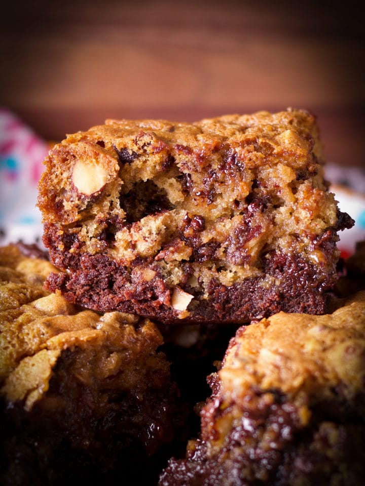 A tray of gooey chocolate chip cookie brownie bars.