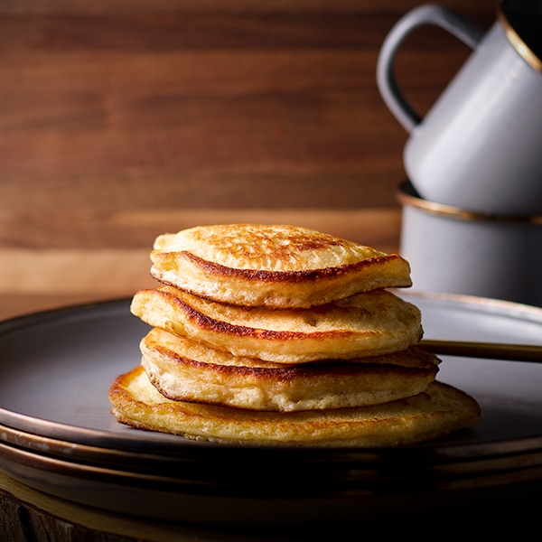 A stack of Homemade Buttermilk Pancakes on a plate with a fork.