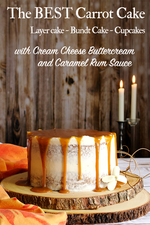 A carrot cake covered in cream cheese buttercream and caramel rum sauce on a wooden tray with candles in the background.